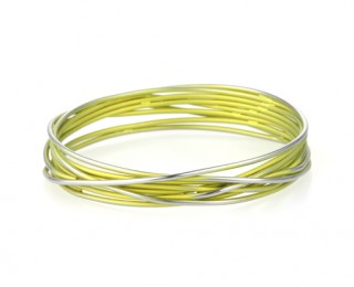 This titanium chaos bangle is available in a range of colours