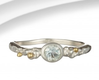 Slim silver bobble ring with blue topaz