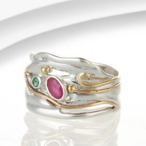 Silver ring with ruby and emerald