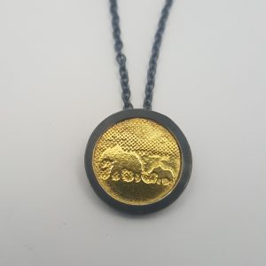 Elephant pendant by Charlotte Lowe in oxidised silver and 9ct gold plate.