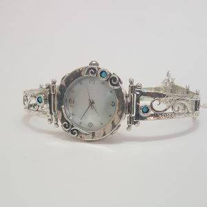 Silver watch with scrolls and turquoise